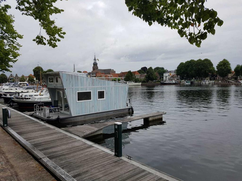 Tiny Houseboat for rent at Boat Rental Friesland | Enjoying the water